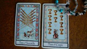 タロットカード:剣の10(正位置)、カップの10(正位置)