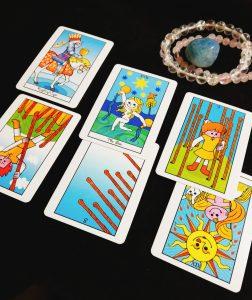 タロットカード:ワンド7逆位置、ワンド9正位置、太陽逆位置